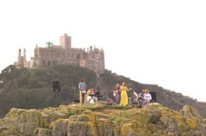 The band performing live on Chapel Rock in front of St. Michael's Mount, Cornwall in 2001